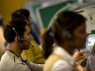 Indian workers answer telephone calls at a call-centre in Gurgaon. Findlay Kember/AFP