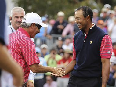 US team player Woods shakes hands with team captain Couples after the US won the Presidents Cup. Reuters