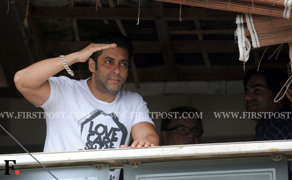 Salman Khan waves to the crowd outside his residence, Galaxy Apartments, at Carter Road, Mumbai. Sachin Gokhale/Firstpost