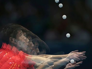 China's Zhang Jike sets to serve to Germany's Timo Boll. AP