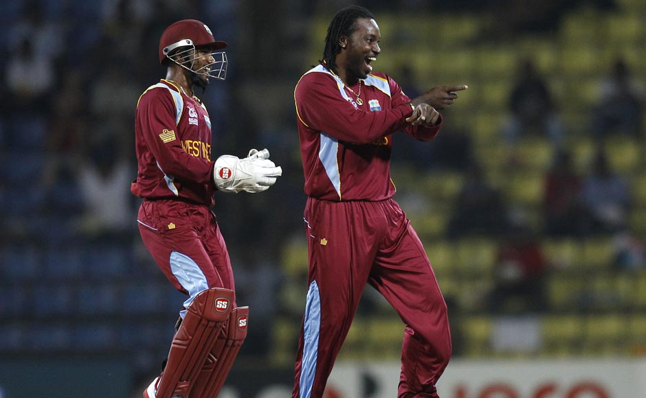 West Indies bowler Chris Gayle dances after taking the wicket of England's Jonny Bairstow, not seen, during the ICC Twenty20 Cricket World Cup Super Eight match in Pallekele, Sri Lanka. Aijaz Rahi/ AP