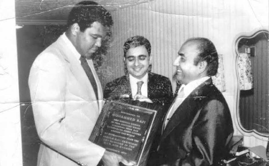 Muhammad Ali hands over a plaque to Mohammed Rafi in an undated picture from Yasmin Rafi's collection.