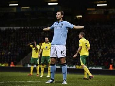 Manchester City's Dzeko celebrates after scoring a goal against Norwich City during their English Premier League soccer match in Norwich. Reuters