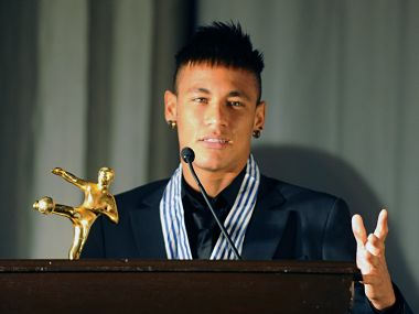 Brazilian football player Neymar speaks after receiving the best South American football player award by Uruguayan newspaper El Pais. AFP