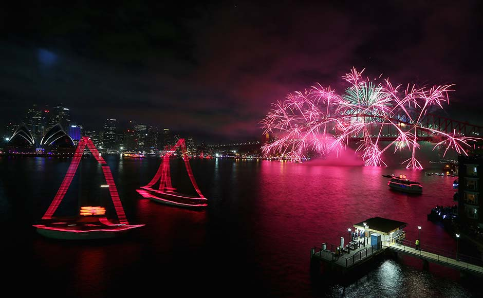 Fireworks light up the sky above the Sydney Harbour Bridge at midnight during New Years Eve celebrations on Sydney Harbour on December 31, 2012 in Sydney, Australia. Cameron Spencer/Getty Images
