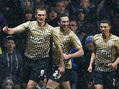 Bradford City's Hanson celebrates with teammates after scoring during their English League Cup semi-final second leg soccer match against Aston Villa in Birmingham. Reuters