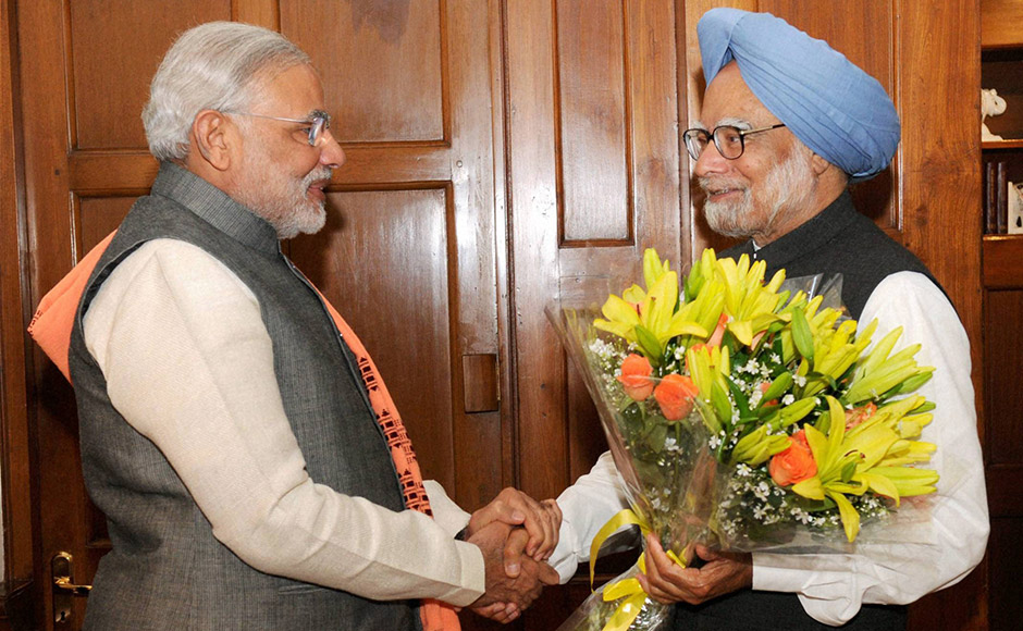 Gujarat CM Narendra Modi greets Prime Minister Manmohan Singh during the former's visit to Delhi. PTI