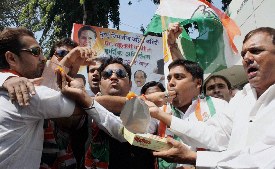 Congress Party members celebrate the hanging of Afzal Guru at the party office in Mumbai on Saturday. PTI
