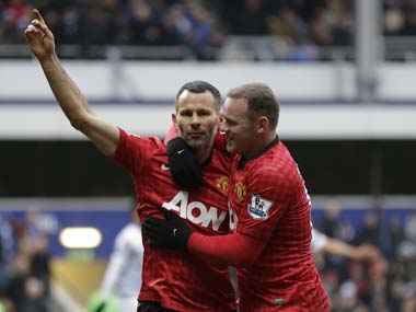 Ryan Giggs celebrates after scoring against QPR. AP