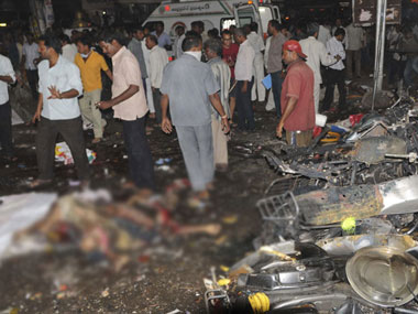 People gather at the blast site in Hyderabad. AP