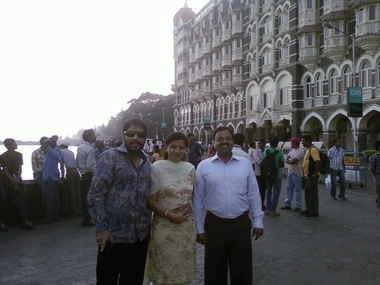 Former minister Gopal Kanda (left) with Geetika's parents in Mumbai. Image courtesy Geetika Sharma's family.