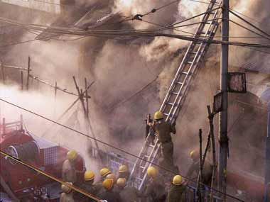 Firefighters battling the blaze: PTI