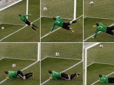 Germany's goalkeeper Manuel Neuer looks at a ball that hit the bar to bounce over the line during the World Cup. AP