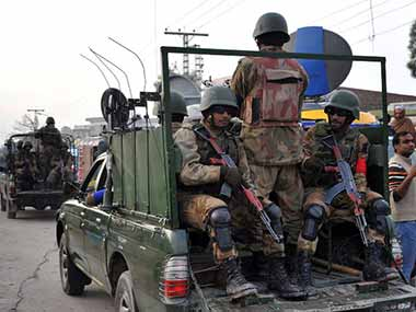 Pakistan Army officials patrol a city in Pakistan. AFP