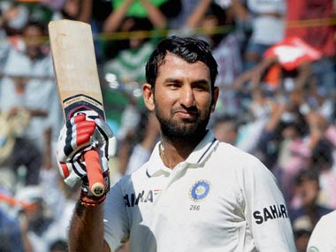 Cheteshwar Pujara celebrates his hundred. PTI