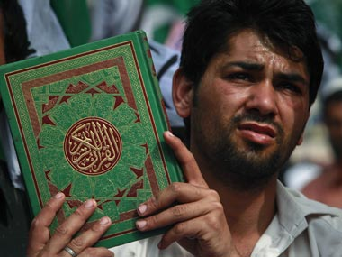 Representational image. A Muslim holds the Holy Koran. Reuters