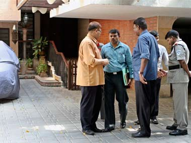 Mumbai Police officers at CSK CEO Gurunath Meiyappan's home in Chennai. PTI