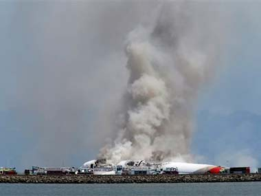 Smokes rises from Asiana Flight 214 after it crashed at San Francisco International Airport: AP