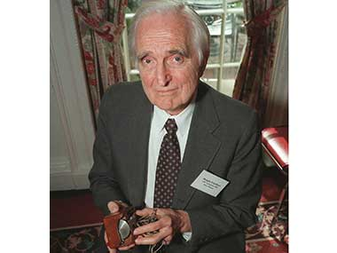 In this April 9, 1997 file photo, Doug Engelbart, inventor of the computer mouse poses with the computer mouse he designed, in New York.