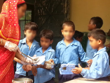 A meal being served under the scheme in a Delhi school. Arlene Chang/ Firstpost