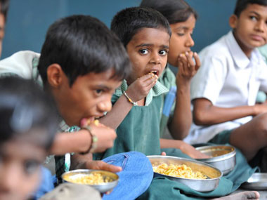 Children in a government school having mid day meals. AFP.