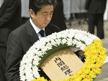 Japan's Prime Minister Shinzo Abe offers a wreath at Nagasaki Peace Park in Nagasaki. AP