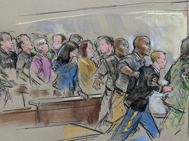 In this courtroom sketch, Army Pfc. Bradley Manning is escorted out of a courtroom after his sentencing. AP