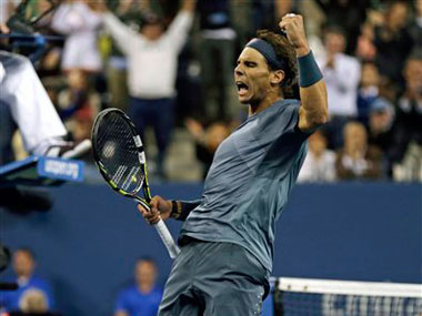 Nadal celebrates after scoring a point against Djokovic: AP