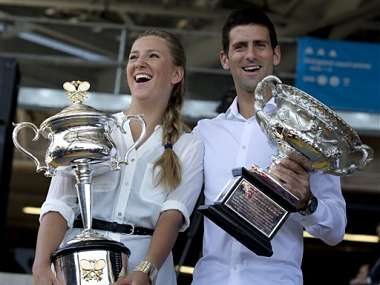 Defending champions Victoria Azarenka of Belarus and Serbia's Novak Djokovic pose with their trophies. AP