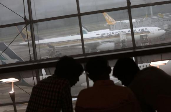 Singapore tells airlines to review conflict zone risk - Singapore airlines kuala lumpur office ...