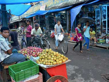 Shops get opened after curfew was relaxed from 6 am to 12 noon in tension-gripped Golaghat on Friday. PTI
