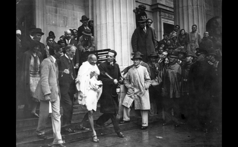 <p> Crowd flanked Mahatma Gandhi when he left the Friends' Meeting House, Euston Road, after attending the Round Table Conference on Indian constitutional reform. Getty Images</p>