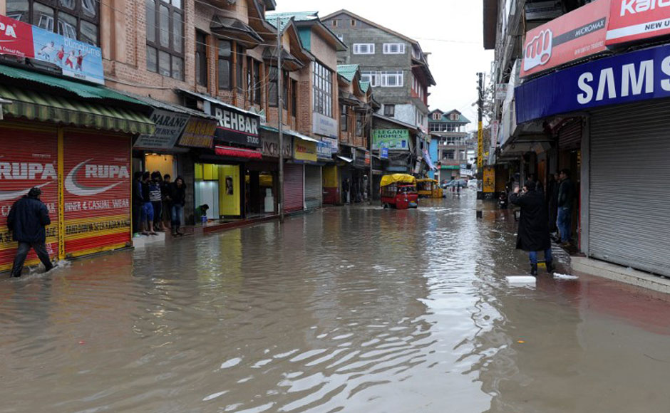 A flooded road is seen in the centre of Srinagar after heavy rainfall on Sunday. Parts of Srinagar were waterlogged following sustained rains since Saturday, with forecasters warning the wet weather would likely continue. Floods and landslides triggered by heavy monsoon rains had devastated parts of Indian-administered Kashmir in September 2014. AFP