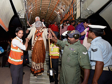 Indians rescued from Nepal arrive at Pallam airport. PTI