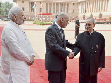 President Pranab Mukherjee with his Afghanistan counterpart Mohammad Ashraf Ghani at the forecourt of Rashtrapati Bhavan during the ceremonial welcome  in New Delhi on Tuesday. Prime Minister Narendra Modi is also seen. PTI