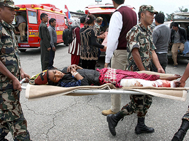 Injured persons being shifted in earthquake hit Nepal. PTI