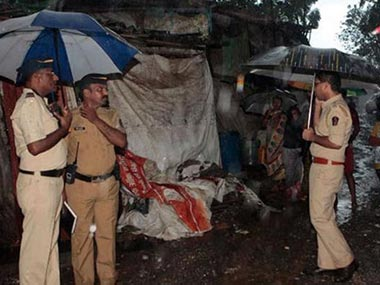 Mumbai Police inspect the location where the alcohol was made. PTI