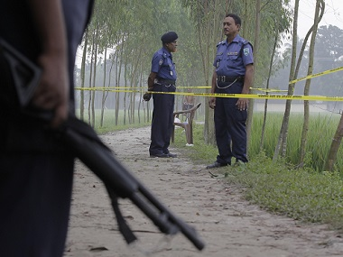 File image of Bangladeshi security officers at the site where Japanese Kunio Hoshi was killed in Bangladesh. AP