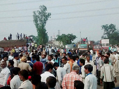 People protest against the killing of Dalit children in Faridabad. PTI