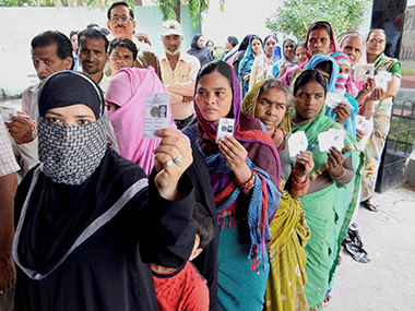 Voters wait to cast their ballot in Bihar. PTI