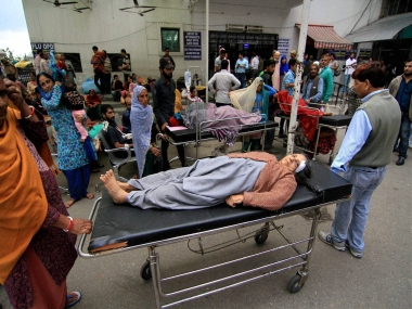 An injured people take first-aid at Govt Medical College hospital after earthquake in Jammu on Monday. PTI