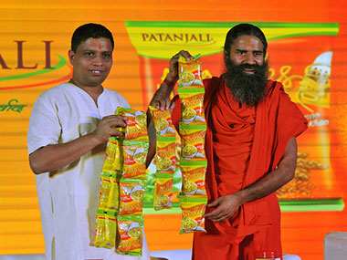 Acharya Balkrishna, CEO, Patanjali Ayurved and Baba Ramdev. Getty Images