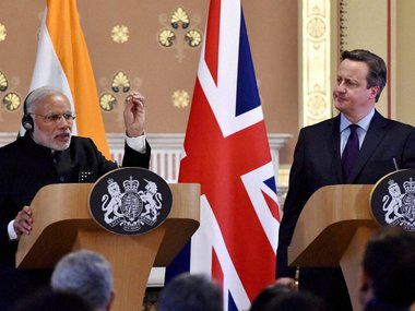 PM Narendra Modi (left) with British PM David Cameron. PTI