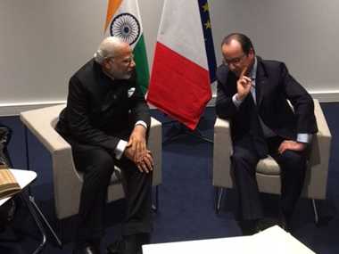 Prime Minister Narendra Modi with French President Francois Hollande at the Paris climate change summit. @MEAIndia