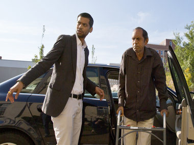 Sureshbhai Patel and his son arriving at the courthouse/AP