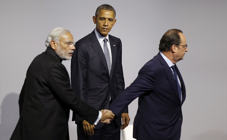 US President Barack Obama along with Prime Minister Narendra Modi and French President, Francois Hollande after the launch of Mission Innovation, a landmark commitment to dramatically accelerate public and private global clean energy innovation, during the World Climate Change Conference 2015 (COP21) in Paris, France. Reuters