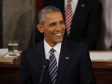 President Barack Obama smiles as he delivers his State of the Union address. Reuters