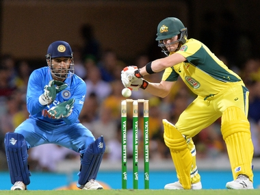 MS Dhoni and Steve Smith in action in the 2nd ODI at Brisbane. Getty