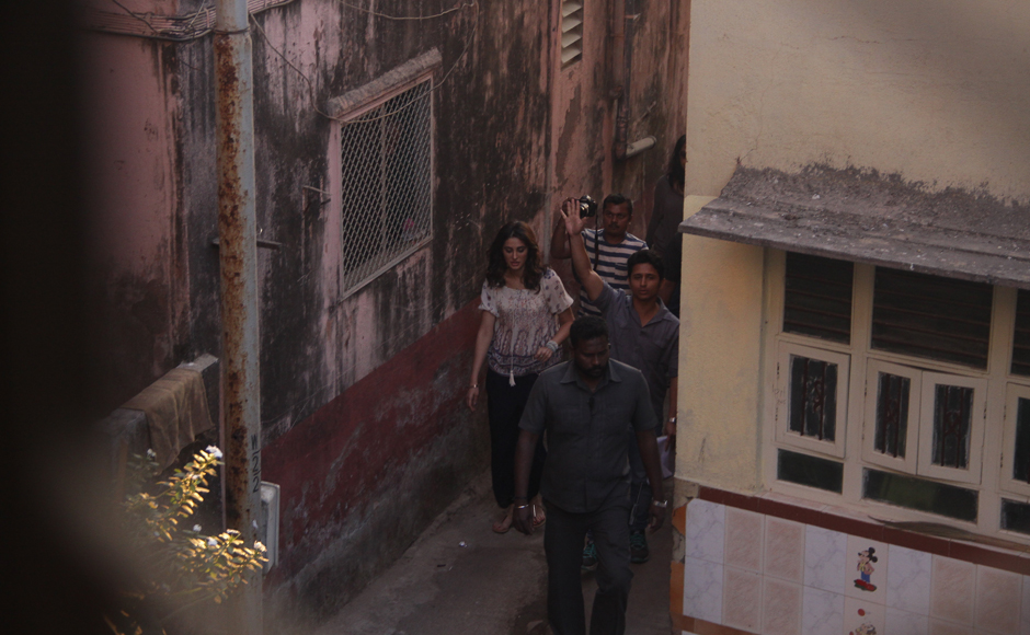 Nargis Fakhri walks through the narrow lanes in Worli, Mumbai supposedly doing a recce for her next film. Firstpost