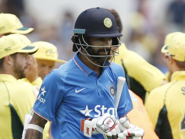 Shikhar Dhawan walks back after a cheap dismissal in Perth. AP